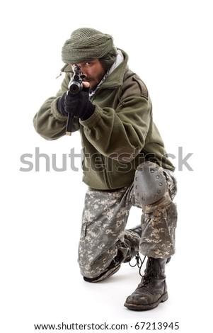 Image of young terrorist pointing gun. - stock photo