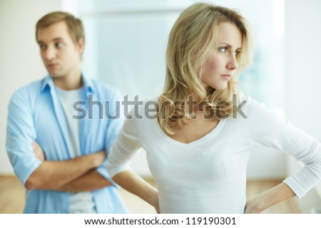 Image of young upset female in quarrel with her husband - stock photo