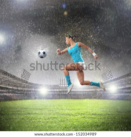 Image of young woman football player hitting ball - stock photo