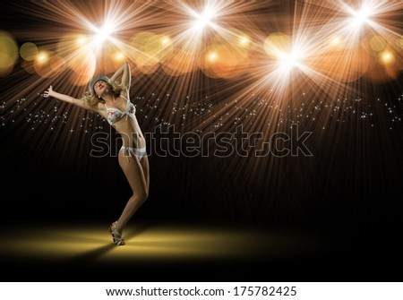image of young woman in bikini and hat dancing, isolated on black background - stock photo
