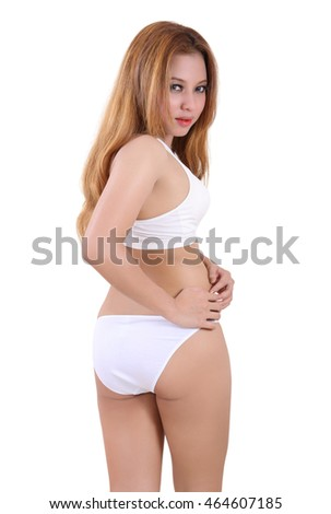 Image of young woman in white fitness clothes