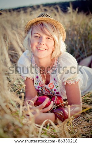 Image of young woman on wheat field - stock photo