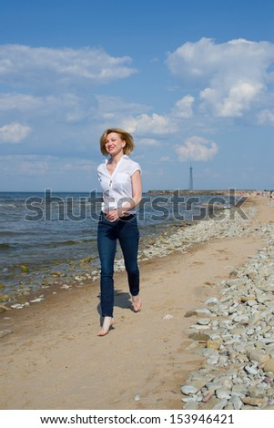 Image of young woman running on the beach