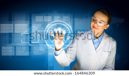 Image of young woman scientist in goggles against media screen - stock photo