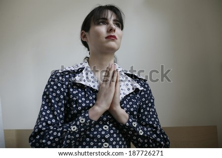 image of young woman with hands in prayer , image of young woman having prayer  - stock photo