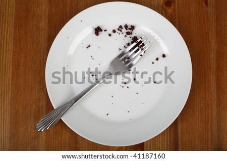 image on breaking diet crumbles of eaten cake - stock photo