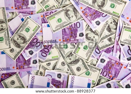 Image pile of banknotes - dollars and euros - stock photo