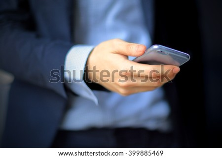 Image selective focus at hand of businessman working with smartphone,  concept of successful business - stock photo