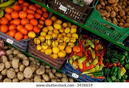 Image shows a fruit and vegetable market stand - stock photo
