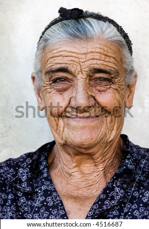 Image shows a happy old lady from a village in Greece - stock photo