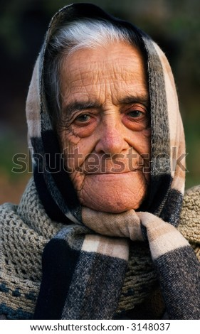 Image shows a portrait of an old proud traditional Greek lady from a village in Mani peninsula