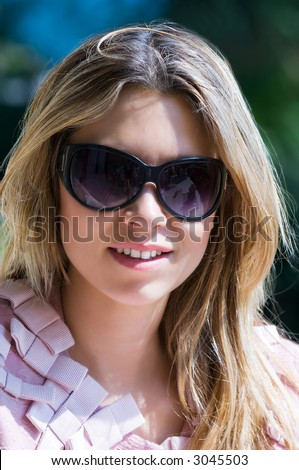 Image shows a pretty girl with sunglasses