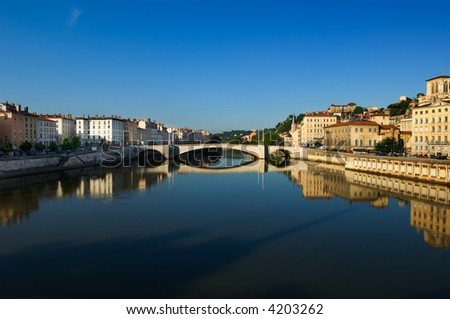 Image shows the river Saone running through the city of Lyon in France - stock photo