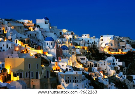 Image shows the village of Oia at dusk, on the beautiful island of Santorini, Greece - stock photo