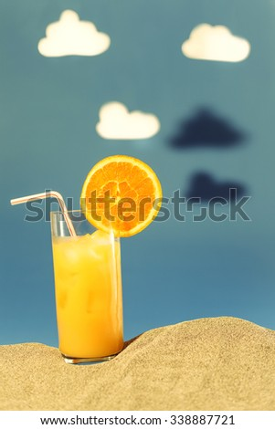 Image simulating hot summer scenery with fresh drink with cutout clouds - stock photo
