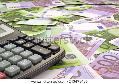 Image the euro money with calculator  - stock photo