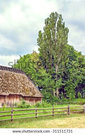 Image Ukrainian wooden barn Thatched locked up - stock photo