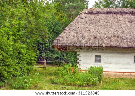 Image Ukrainian wooden hut thatched locked up - stock photo
