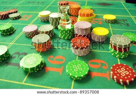 image with a casino roulette table layout with chips and dolly - stock photo