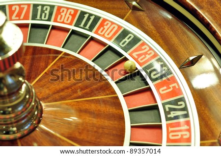 image with a casino roulette wheel with the ball on number 23