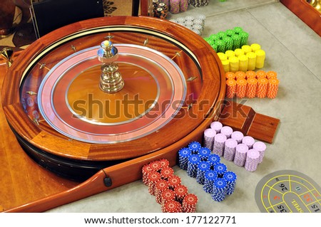 image with a casino spinning roulette wheel with the ball