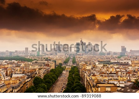 image with dramatic clouds over the Champs Elysees in Paris - stock photo