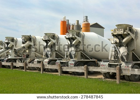 Image with mixer machines outdoors - stock photo