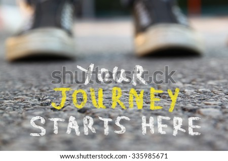 image with selective focus over asphalt road and person with handwritten text - your journey starts here.  education and motivation concept - stock photo