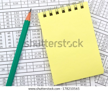 Image yellow notebook on background of numbers/Notebook on the background of digits - stock photo