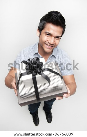 Images of asian shopping in a mall with bags and presents - stock photo