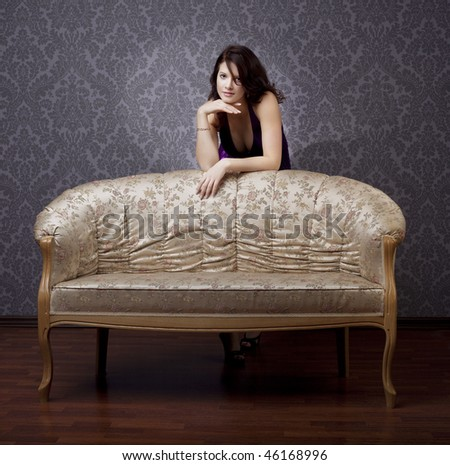 Images of beautiful glamorous girl on the couch - stock photo
