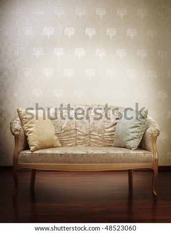 Images of the luxury gold glamorous sofa in the background of vintage wallpaper - stock photo