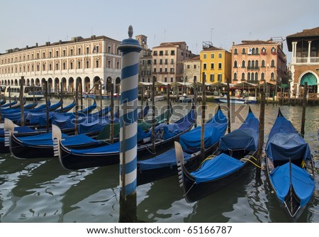 Images of Venetian gondolas on the Grand Canal