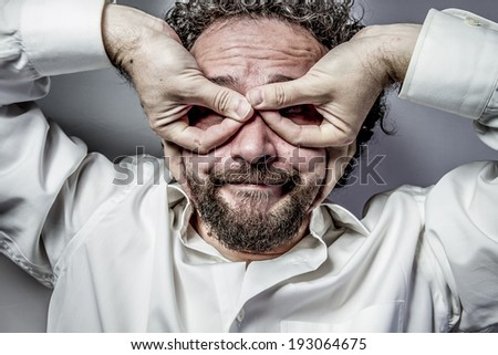 imagination and madness, man with intense expression, white shirt - stock photo