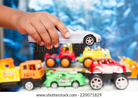 Imagination of a child bored with jumping over a car - stock photo