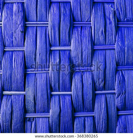 Imaginative bright blue woven reed / wood / wooden abstract background texture, crisscross pattern. - stock photo