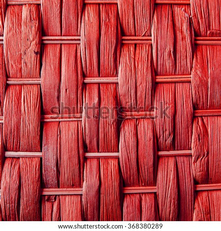 Imaginative red woven reed / wood / wooden abstract background texture, crisscross pattern. - stock photo