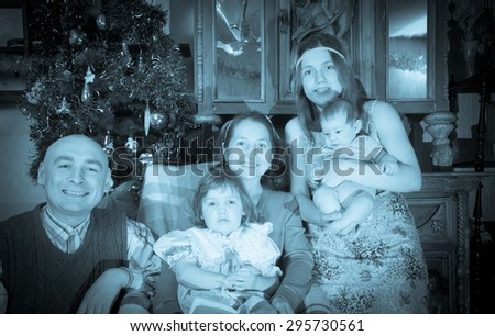 Imitation of ancient photo of Christmas portrait of happy family