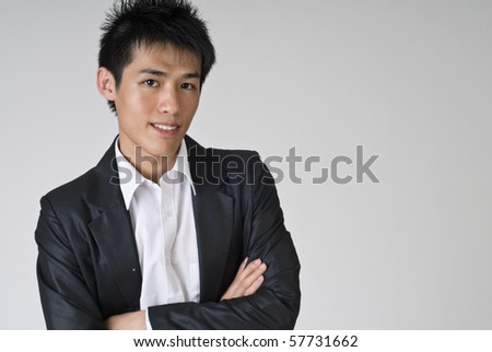 Immature young business man smiling, closeup portrait with copyspace. - stock photo