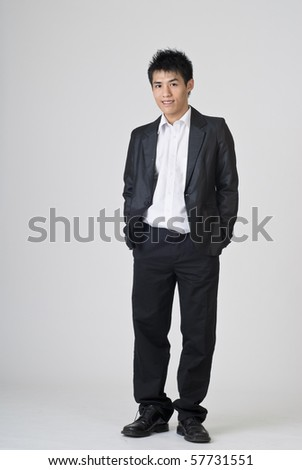 Immature young businessman, full length portrait of Asian office man. - stock photo