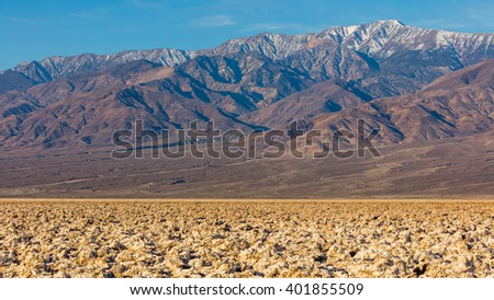 Immense area of rock salt eroded by wind and rain into jagged spires. A large salt pan on the floor of Death Valley. Devil's Golf Course, Death Valley National Park - stock photo
