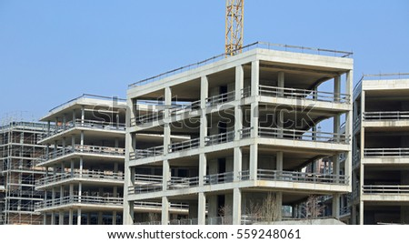 immense building under construction with concrete walls in the city