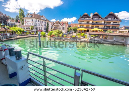 IMMENSEE, SWITZERLAND - July 29, 2016 - Immensee village from famous boat at Lake Zug on a sunny day with blue sky and clouds in summer, Canton of Zug, Switzerland