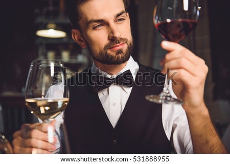 Immersed alcohol critic fixedly gazing at wine