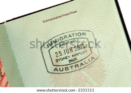 Immigration Australia - Immigration Stamp for Arrival In Australia On Green Passport Page - stock photo