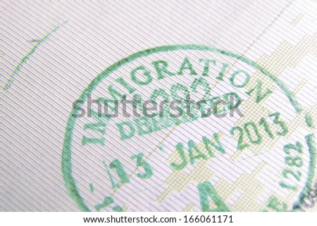 immigration control passport stamp fragment; focus on Immigration word - stock photo