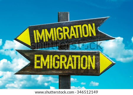 Immigration - Emigration signpost with sky background - stock photo