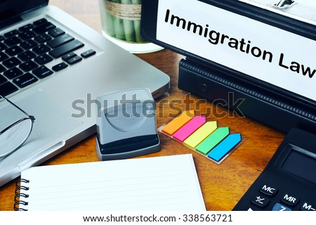 immigration Law - Office Folder on Office Desktop with Office Supplies. Business Concept on Toned and Blurred Background - stock photo