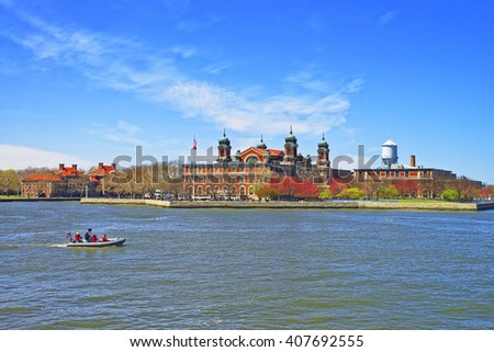 Immigration station in Ellis Island, USA, and boat in Upper New York Bay. It was a gateway for immigrants who came to immigrant inspection. Tourists on board - stock photo