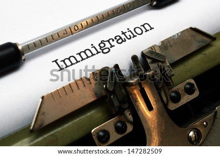 Immigration text on typewriter - stock photo